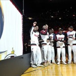 Oct 30, 2012; Miami, FL, USA; Miami Heat players admire their NBA championship rings while the NBA championship banner is raised before the game against the Boston Celtics at American Airlines Arena. The Heat won 120-107. Mandatory Credit: Steve Mitchell-US PRESSWIRE