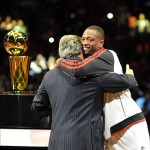 Oct 30, 2012; Miami, FL, USA; Miami Heat owner Micky Arison (left) embraces shooting guard Dwyane Wade (right) after Wade received his NBA championship ring before a game against the Boston Celtics at American Airlines Arena. The Heat won 120-107. Mandatory Credit: Steve Mitchell-US PRESSWIRE