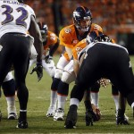 Sep 5, 2013; Denver, CO, USA; Denver Broncos quarterback Peyton Manning calls a play at the line of scrimmage during the second half against the Baltimore Ravens at Sports Authority Field at Mile High. Mandatory Credit: Chris Humphreys-USA TODAY Sports