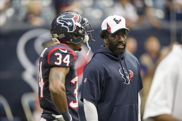 Aug 17, 2013; Houston, TX, USA; Houston Texans safety Ed Reed (20) talks with cornerback A.J. Bouye (34) before the game against the Miami Dolphins at Reliant Stadium. The Texans defeated the Dolphins 24-17. Mandatory Credit: Jerome Miron-USA TODAY Sports