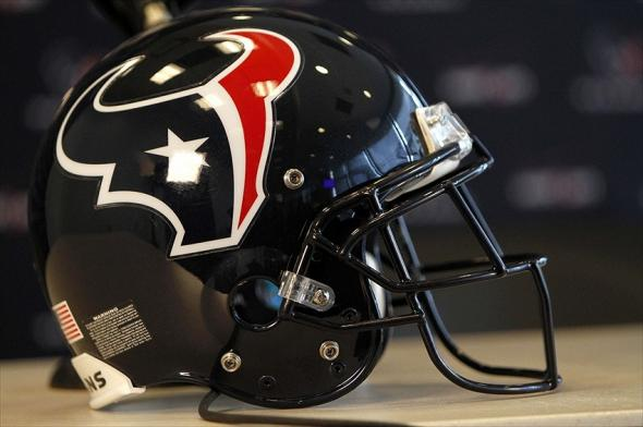 Apr 27, 2012; Houston, TX, USA; Houston Texans helmet on a table during a press conference to introduce first round draft pick defensive end Whitney Mercilus of Illinois at Reliant Stadium. Mandatory Credit: Brett Davis-USA TODAY Sports