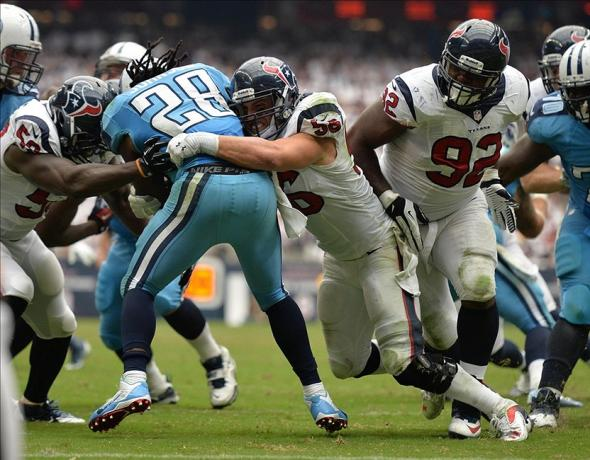 Sep 15, 2013; Houston, TX, USA; Houston Texans inside linebacker Brian Cushing (56) stuffs Tennessee Titans running back Chris Johnson (28) on the one yard line during the second half at Reliant Stadium. The Texans won 30-24. Mandatory Credit: Thomas Campbell-USA TODAY Sports