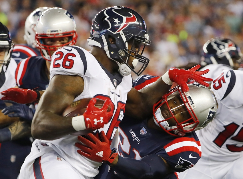 9558367-lamar-miller-malcolm-butler-nfl-houston-texans-new-england-patriots-1
