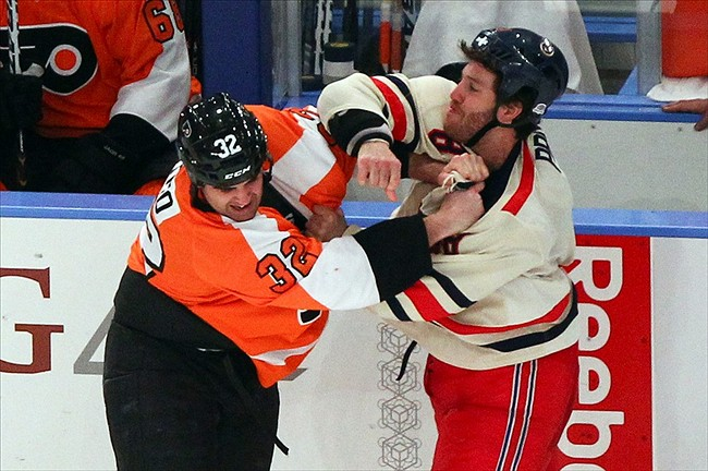 Brandon Prust taking out the trash. (Debby Wong-US PRESSWIRE)