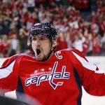 Apr 23, 2013; Washington, DC, USA; Washington Capitals left wing Alex Ovechkin (8) celebrates after scoring an empty net goal against the Winnipeg Jets in the third period at Verizon Center. The Capitals won 5-3 and clinched the Southeast Division championship. Mandatory Credit: Geoff Burke-USA TODAY Sports