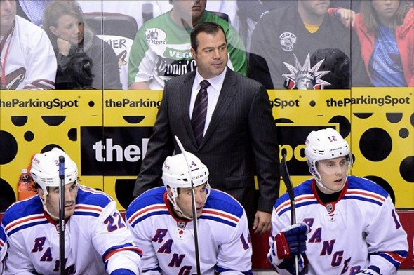 Oct 3, 2013; Glendale, AZ, USA; New York Rangers head coach Alain Vigneault looks on during the first period against the Phoenix Coyotes at Jobing.com Arena. Mandatory Credit: Matt Kartozian-USA TODAY Sports