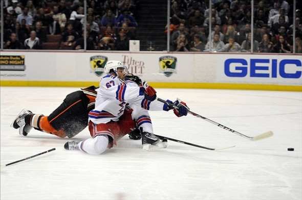 Oct 10, 2013; Anaheim, CA, USA; New York Rangers left wing Benoit Pouliot (67) attempts a shot defended by Anaheim Ducks defenseman Francois Beauchemin (23) during the first period at Honda Center. Mandatory Credit: Kelvin Kuo-USA TODAY Sports