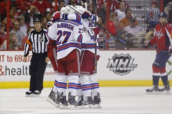 Oct 16, 2013; Washington, DC, USA; New York Rangers defenseman John Moore (17) celebrates with teammates after scoring a goal against the Washington Capitals in the second period at Verizon Center. Mandatory Credit: Geoff Burke-USA TODAY Sports
