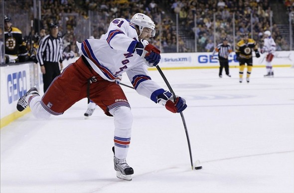 May 16, 2013; Boston, MA, USA; New York Rangers left wing Rick Nash (61) takes a shot on goal during the first period in game one of the second round of the 2013 Stanley Cup Playoffs against the Boston Bruins at TD Garden. Mandatory Credit: Greg M. Cooper-USA TODAY Sports