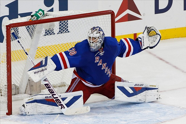 Nov 4, 2013; New York, NY, USA; New York Rangers goalie Henrik Lundqvist (30) stretches for an incoming puck during the third period against the Anaheim Ducks at Madison Square Garden. Anaheim won 2-1. Mandatory Credit: Anthony Gruppuso-USA TODAY Sports