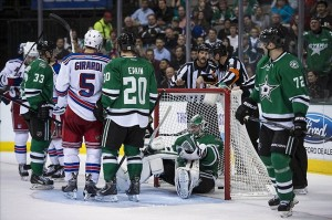Nov 21, 2013; Dallas, TX, USA; The referees confer and wave off a goal scored New York Rangers defenseman Anton Stralman (6) against Dallas Stars goalie Kari Lehtonen (32) during the second period at American Airlines Center. Mandatory Credit: Jerome Miron-USA TODAY Sports