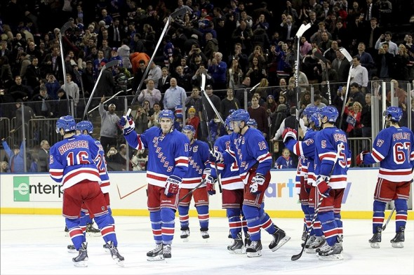 Jan 10, 2014; New York, NY, USA; The New York Rangers celebrate after defeating the Dallas Stars following a game at Madison Square Garden. The Rangers defeated the Stars 3-2. Mandatory Credit: Brad Penner-USA TODAY Sports