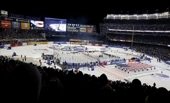 Jan 29, 2014; New York City, NY, USA; A general view during the playing of the national anthem before the Stadium Series hockey game between the New York Islanders and the New York Rangers at Yankee Stadium. Mandatory Credit: Anthony Gruppuso-USA TODAY Sports
