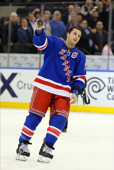 Feb 4, 2014; New York, NY, USA; New York Rangers right wing Ryan Callahan (24) acknowledges the crowd after being names the star of the game against the Colorado Avalanche at Madison Square Garden. The Rangers won 5-1. Mandatory Credit: Adam Hunger-USA TODAY Sports