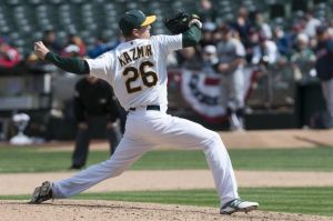Apr 2, 2014; Oakland, CA, USA; Oakland Athletics starting pitcher Scott Kazmir (26) pitches against the Cleveland Indians during the seventh inning in game one of a double header at O.co Coliseum. The Oakland Athletics defeated the Cleveland Indians 6-1. Mandatory Credit: Ed Szczepanski-USA TODAY Sports