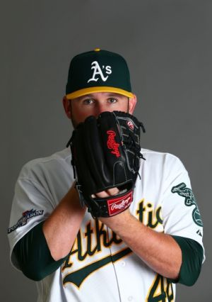 Feb 22, 2014; Phoenix, AZ, USA; Oakland Athletics pitcher Ryan Cook poses for a portrait during photo day at Phoenix Municipal Stadium. Mandatory Credit: Mark J. Rebilas-USA TODAY Sports