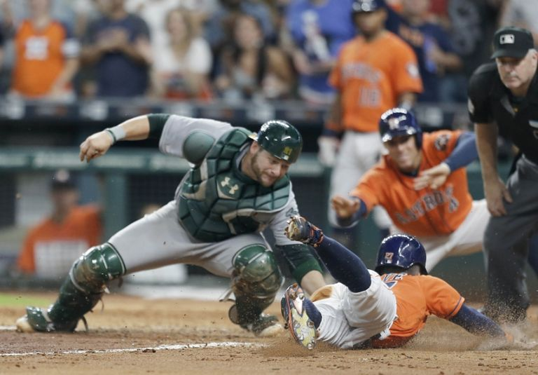 Jose-altuve-stephen-vogt-mlb-oakland-athletics-houston-astros-768x535