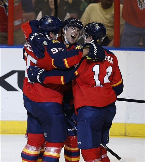 Jan 14, 2014; Sunrise, FL, USA; Florida Panthers right wing Scottie Upshall (19) reacts after his goal against the New York Islanders with left wing Tomas Fleischmann (14) and defenseman Ed Jovanovski (55) in the second period at BB