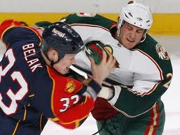 Deceased Enforcers Derek Boogaard and Wade Belak fight. Both were victijms of C.T.E. Photo Credit-Joel Auerbach, US Presswire