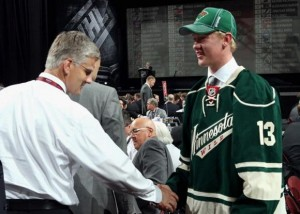 NEWARK, NJ - JUNE 30: Gustav Olofsson greets the team after being selected 46th overall by the Minnesota Wild during the 2013 NHL Draft at Prudential Center on June 30, 2013 in Newark, New Jersey. (Photo by Dave Sandford/NHLI via Getty Images)