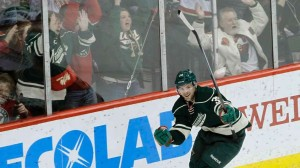 The Minnesota Wild defenseman Nate Prosser celebrates his overtime game winning goal against the Dallas Stars, Saturday January 18, 2014 Mandatory Credit Ann Heisenfelt / Associated Press