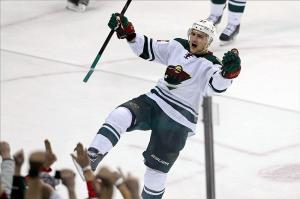 Feb 6, 2014; Saint Paul, MN, USA; Minnesota Wild forward Nino Niederreiter (22) celebrates his game-winning goal in overtime against the Nashville Predators at Xcel Energy Center. The Wild defeated 3-2 in overtime. Mandatory Credit: Brace Hemmelgarn-USA TODAY Sports