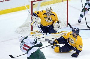 Minnesota Wild winger Zach Parise shoots and scores on Predators goalie Hutton