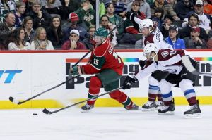 Minnesota Wild winger Dany Heatley caries the puck during a game with the Colorado Avalanche