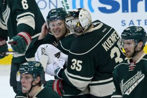 Minnesota WiId goalie Darcy Kuemper conratulates Mikael Granlund on his game winning OT goal