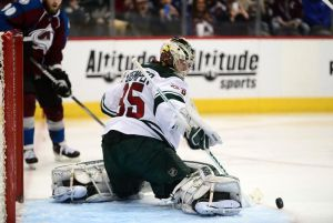 Minnesota Wild goalie Darcy Kuemper turns aside a Colorado shot