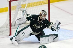 Minnesota Wild goalie Darcy Kuemper makes a save on a Colorado shot