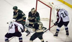 Minnesota Wild goalieDarcy Kuemper makes a late game save.