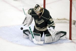Minnesota Wild goal tender Darcy Kuemper makes a third period save against Colorado