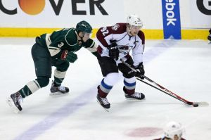 Minnesota Wild forward Charlie Coyle defends against Landeskog of the Avalanche