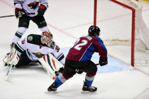 Minnesota Wild goalie Ilya Brygalov watches as Colorado's Gabriel Landeskog scores