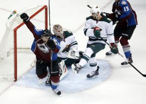 Avalanche player Jamie McGinn Celebrates after scoring on Minnesota Wild goalie Ilya Brzgalov after a turnover by his teammate Kyle Brodziak