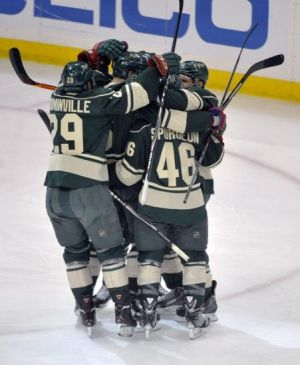 Minnesota Wild players celebrate the games first goal by Jared Spurgeon