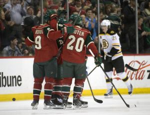 Minnesota Wild players Mikko Koivu and Ryan Suter celebrate a goal by Jason Pominville during the 1st period of Tuesday night against the Boston Bruins in St. Paul, MN