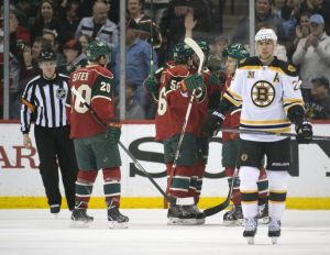 The Minnesota Wild celebrate a goal by forward jason Pominville against the Boson Bruins at the Xcel Energy Center Tuesday night