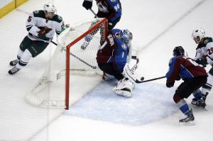 Minnesota Wild right wing Jason Pominville shoots on Avalanche goalie Varlamov