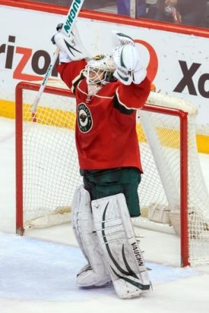 Minnesota Wild goalie John Curry celebates his victory over the St. Louis Blues at the Xcel Energy Center
