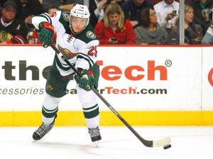 Jonas Brodin of the Minnesota Wild carries the puck up ice against the Chicago Blackhawks on Thursday night at the United Center.