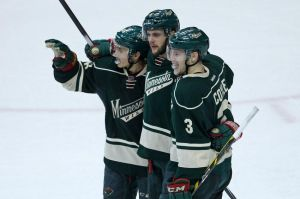 Minnesota Wild players celebrate Marco Scandella's goal