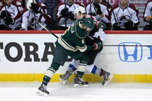 Minnesota Wild defenseman Marco Scandella makes a hit on Colorado's Cody McLeod