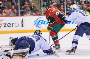 Matt Cooke of the Minnesot Wild take a shot during Thursday's game