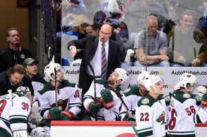 Minnesota Wild Head Coach Mike Yeo instructs his players during a break in the game action.