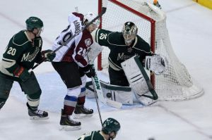 Minnesota Wild goalie Darcy Kuemper makes one of his 21 saves Monday night