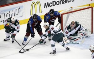 Minnesota Wild defenseman Jared Spurgeon steals the puck from Avalanche forwards