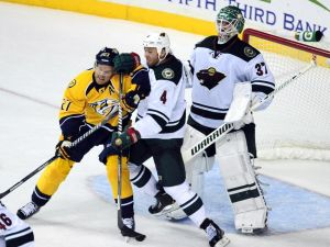 Clayton Stoner clears Patric Hornqvist out of the crease on Oct. 8 2013 in the first meeting of the Minnesota Wild and Nashville Predators