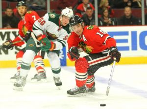 Erik Haula of the Minnesota Wild looks to gain puck possession against Chicago